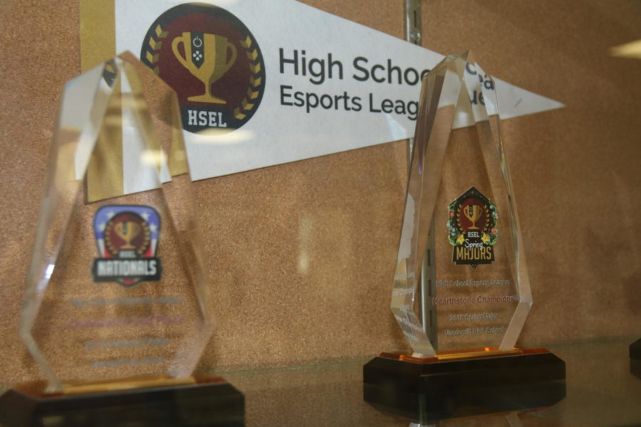 VHS+Esports+team+display+two+of+their+trophies+in+the+school%27s+trophy+case.++