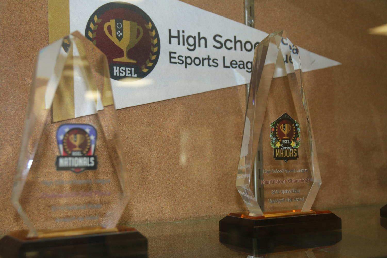 VHS Esports team display two of their trophies in the school's trophy case.