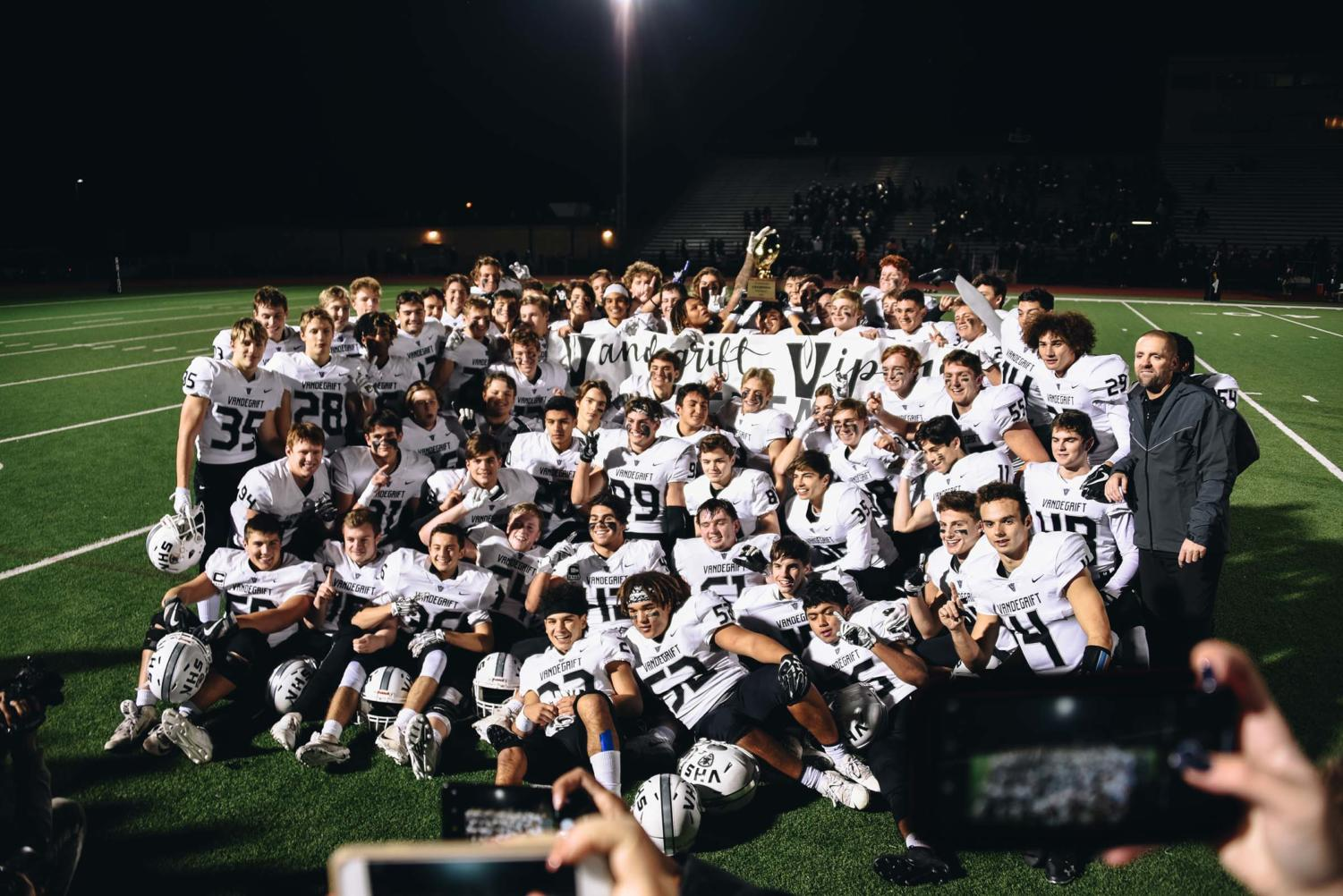 The football team celebrates after a 28-7 win over Stony Point.