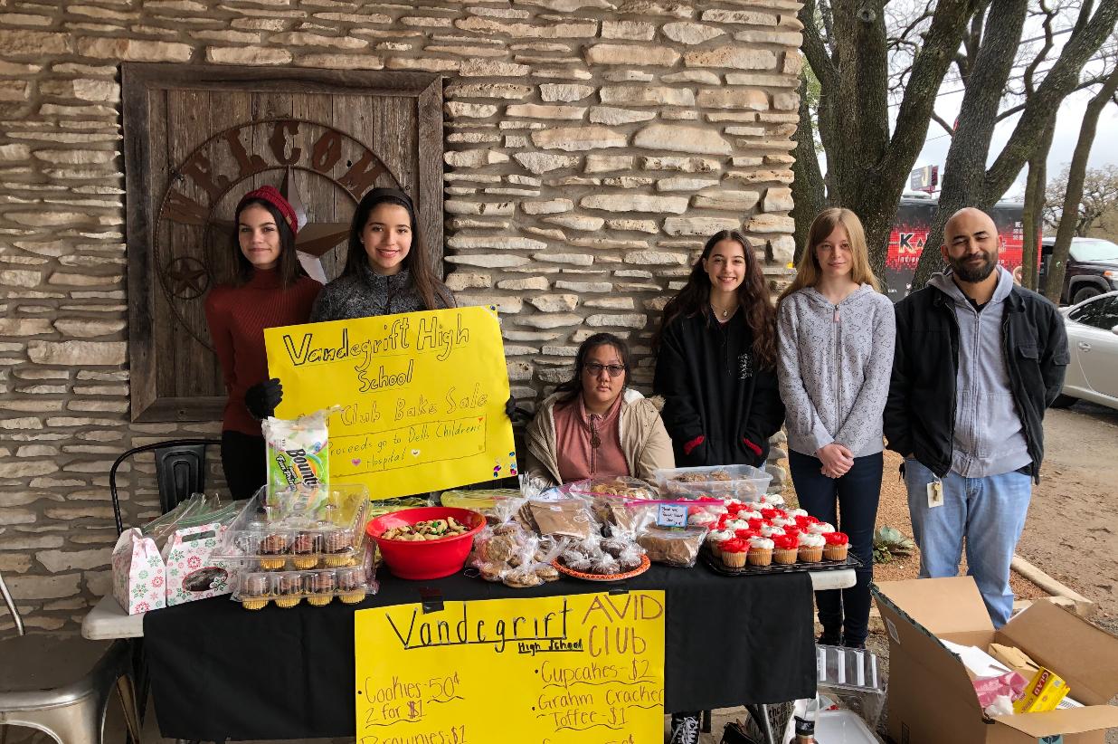 Members advertise bake sale posters