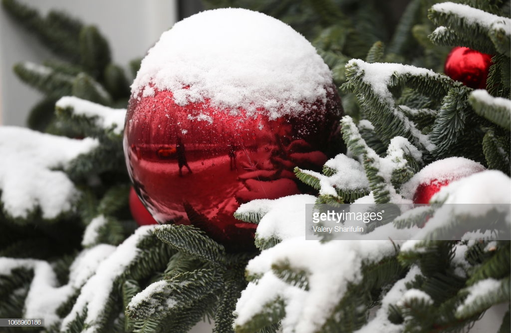 MOSCOW, RUSSIA - DECEMBER 6, 2018: Christmas tree covered in snow in Tverskaya Street in central Moscow after a heavy snowstorm. Valery Sharifulin/TASS (Photo by Valery SharifulinTASS via Getty Images)