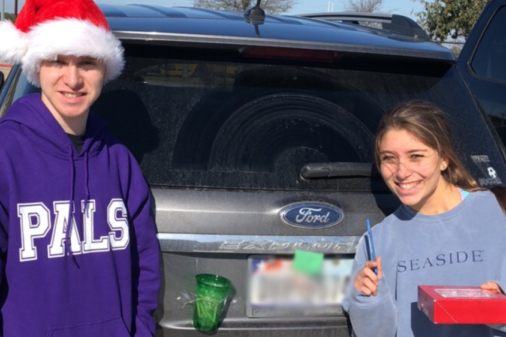 PALS, Allena Gallagher and Zach Chmura leave Candy-Canes with positive notes on students cars.