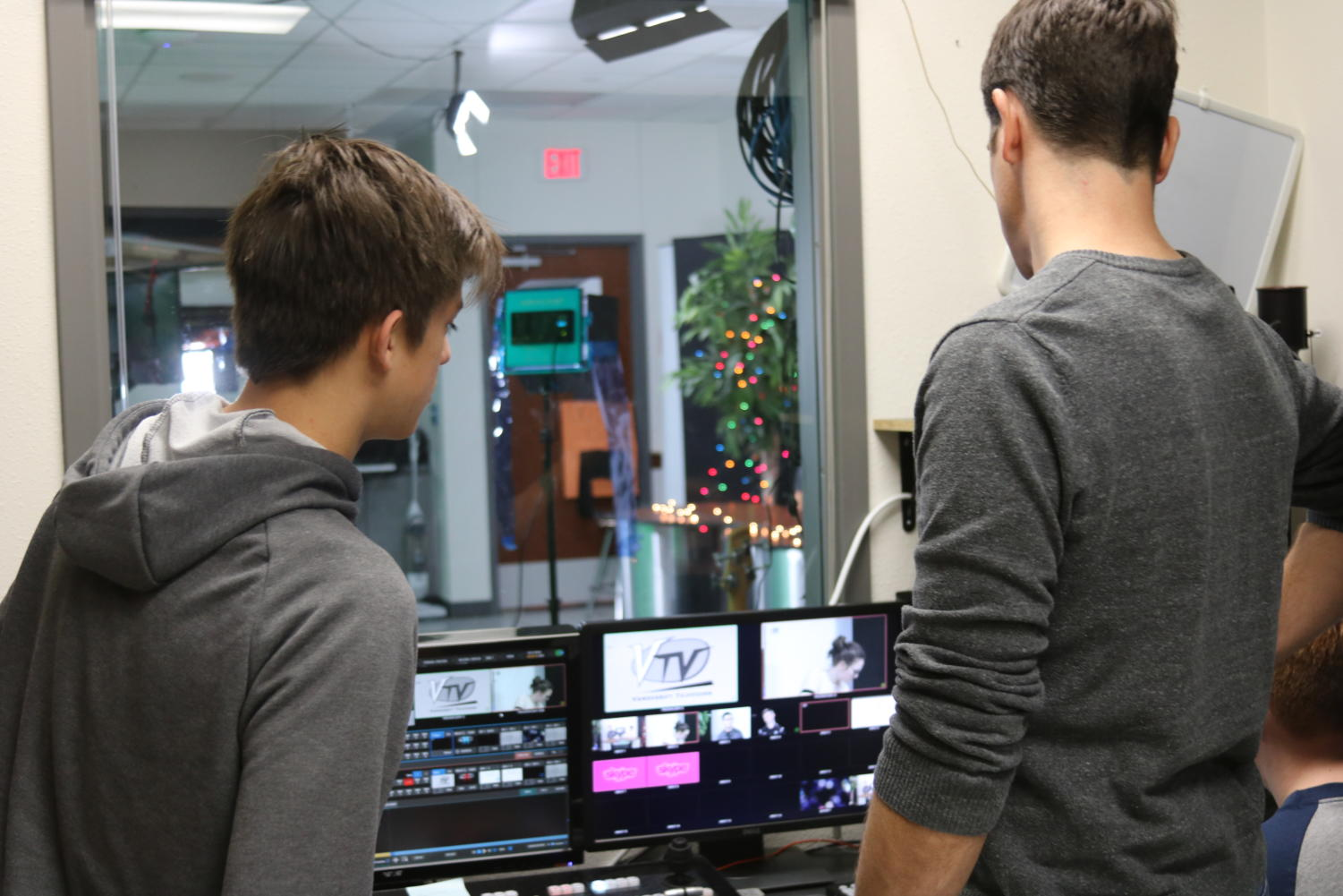 Senior Jasper Tripoli discusses camera set-up with broadcast teacher Mr. Ellis.