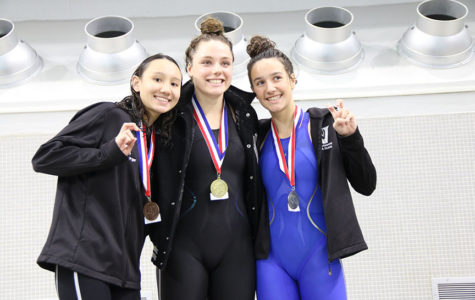 Tailyn Schaufelberger (left), Julianna Birlin (middle) and Julia Roberto (right) all placed in the top three in the Grils 200 Individual Medley at the district meet on Saturday.