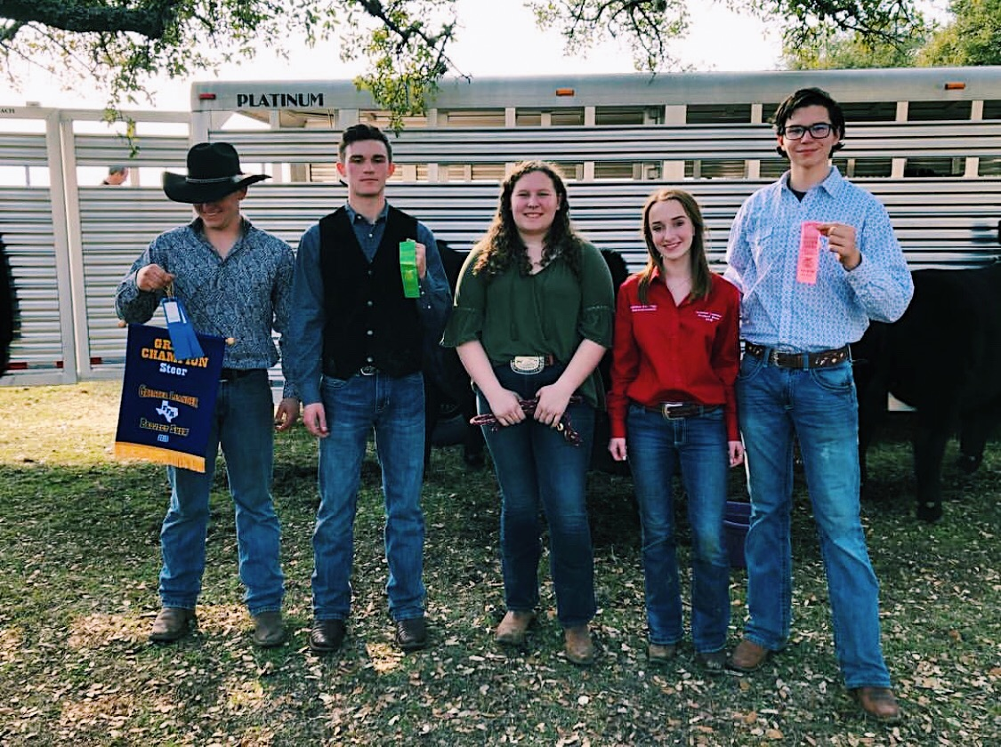 Students (left to right) Zach Sagebiel , Bryce Howsey, Madeleine Rawlings, Camille Barkhuizen, and Zach Roush pose for picture after placing in the cattle show.