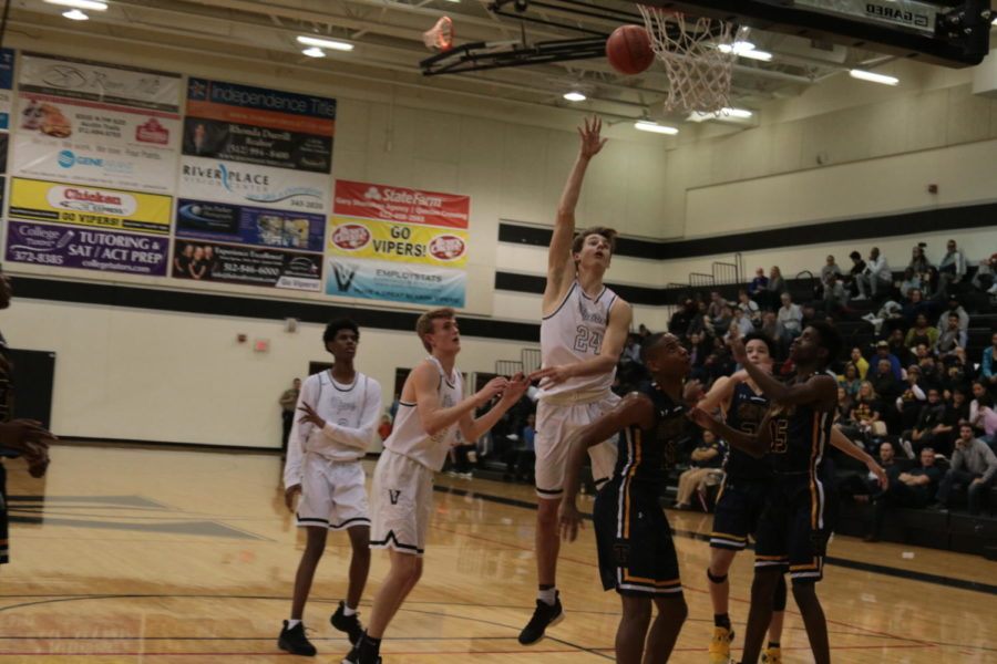 Gabe Reyer drives to the basket and floats the ball in against Stony Point on Feb. 12.