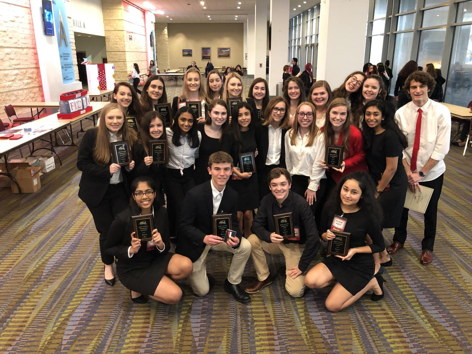FCCLA competitors show off their awards.