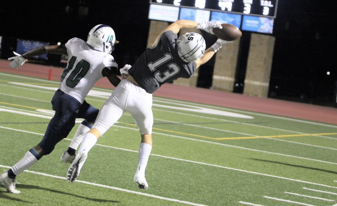 Trey Mongauzy reaches to catch the ball during a home game.