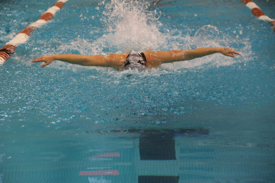 Senior Julianna Birlin hurries down the pool.