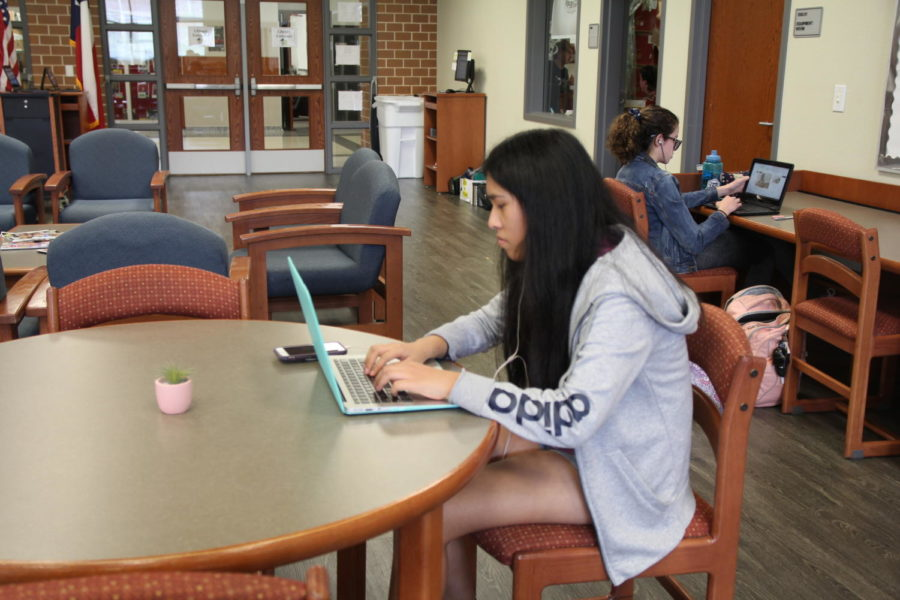 """Junior Kaylee Marquez completes homework in the library during her free time. """"I work in the library because I don't want to do work over the weekend,"""