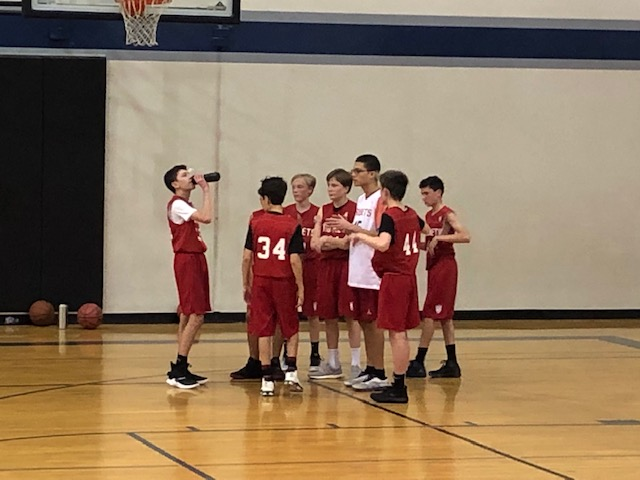 During a timeout, Justin talks to the team about the team's game plan.   Photo Creds: Justin's Mom