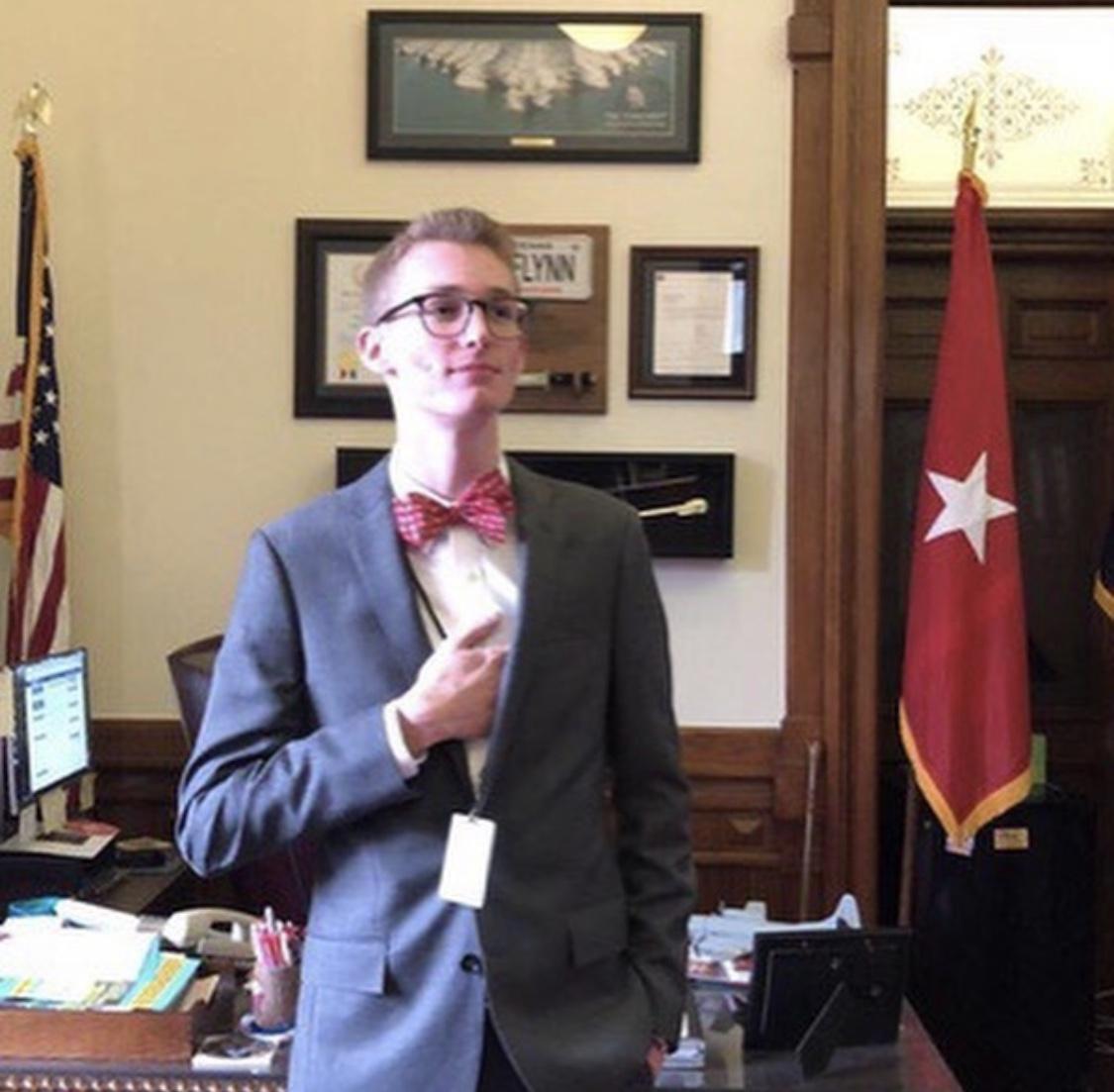 Kyle Legg posing in the House of Representatives.