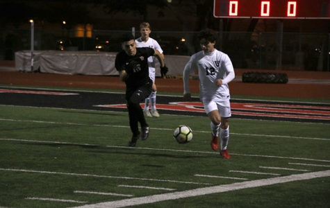 Junior Elliot Keefe takes the ball past a Vista Ridge player