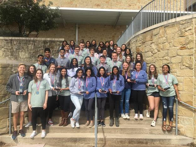 Students+advancing+to+ICDC+pose+for+a+picture+with+their+awards.