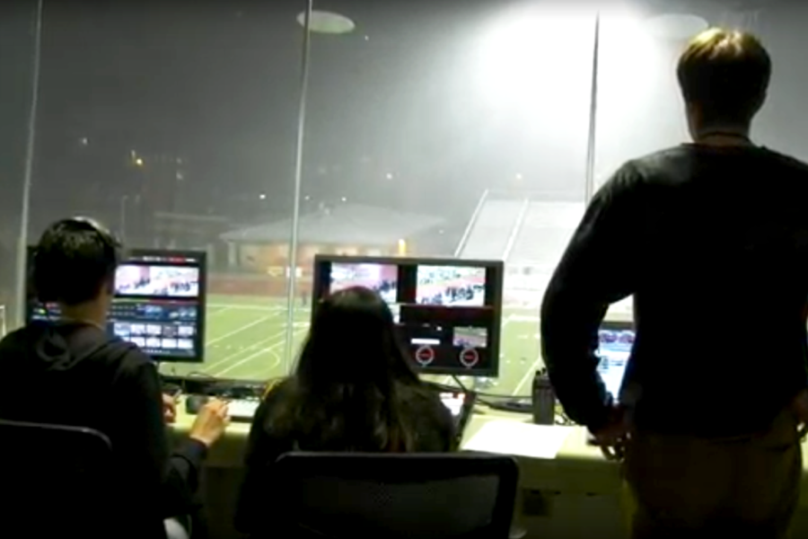Operating from the press box, AV broadcasts the middle school track meet.