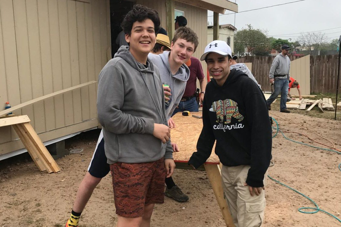 Sophomore Alex Smith (left) with other volunteers building houses is Penitas, Texas.