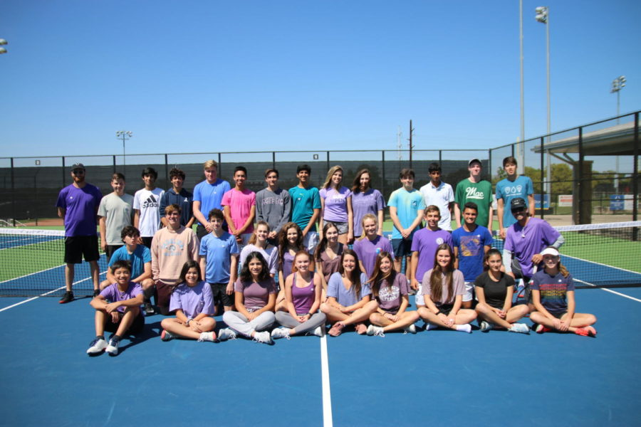 The tennis team smiles as they wear purple for Epilepsy Awareness Day.
