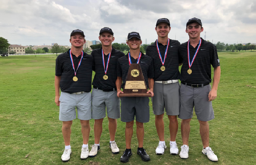 The boys golf team stand with their regional trophy
