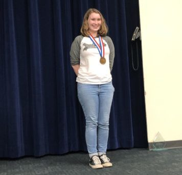 Junior Natalie Brink receives bronze metal in news-writing at the UIL state competition.