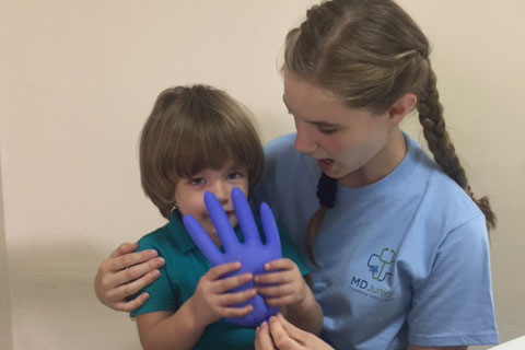 Junior Katie McClellan works at a local clinic during a medical mission trip to Puerto Rico.