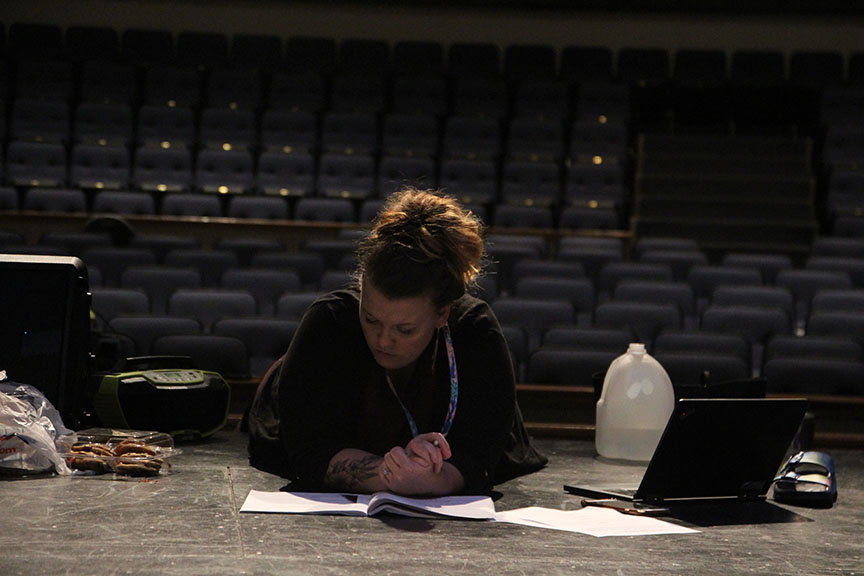 Director Celeste Schneider reads through her script as she writes out the blocking for future scenes. This is Schneider's third musical at Vandegrift and has served as a vocal and acting coach for 10+ years.