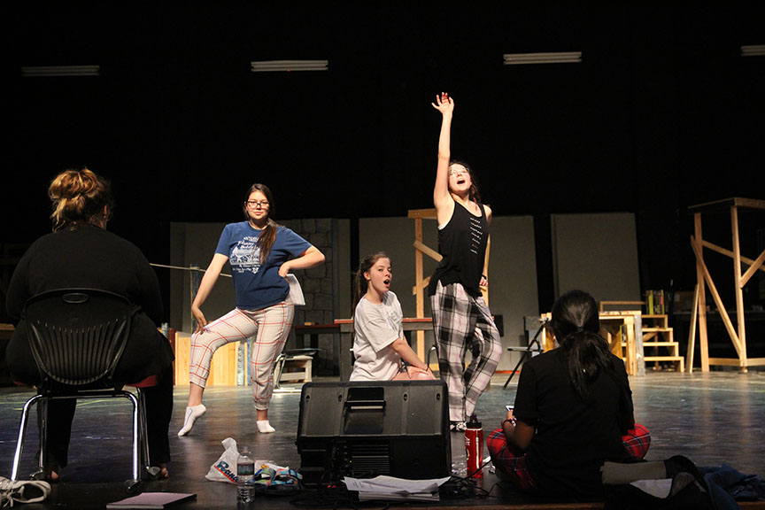 "Kelsey Woodrom (Ali), Gilbert and Claire Lawrence (Lisa) (left to right) strike a pose while performing ""Honey, Honey."" Woodrom is actually a stage manager and was filling in for Kayla Stewart during the full run through of the show."