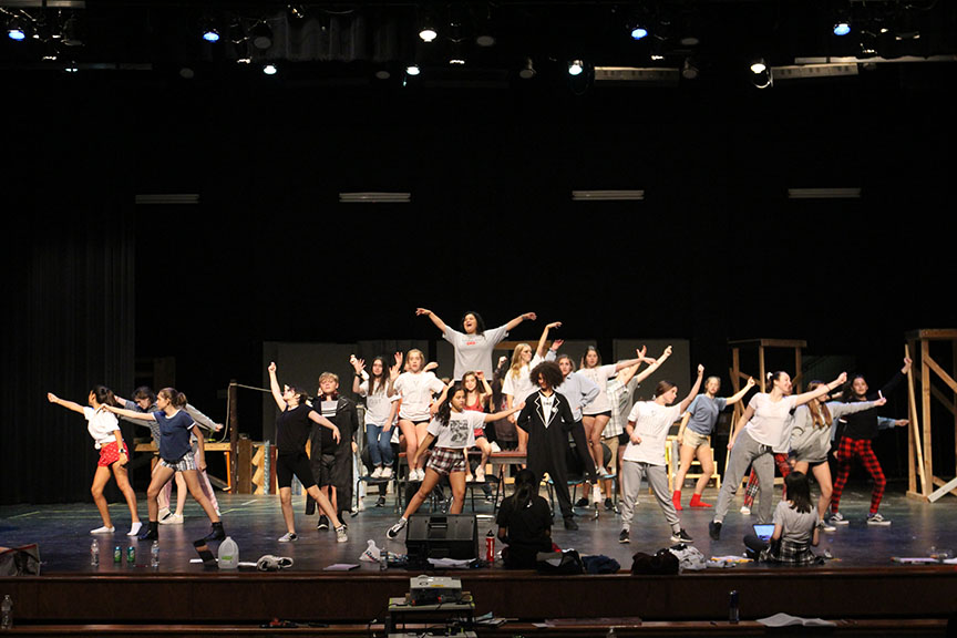 "The ensembles surrounds Mendoza as the cast performs ""Money, Money, Money."" This was the first number that was taught to the cast and the first big number the ensemble is in during the show."