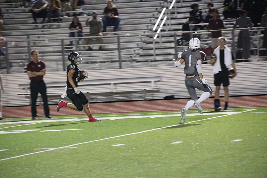 Before the end of the second quarter, Bowen Lewis scores a touchdown.