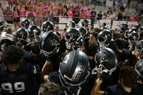 "After the 32-25 win against Round Rock, Vipers huddled up while the band plays the fight song. ""Holding our helmets together after the game listening to our fight song, is awesome. We all just put in the work together to get the win,"" sophomore Landon Thomason said."
