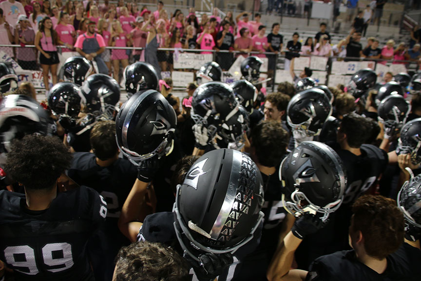 After the 32-25 win against Round Rock, Vipers huddled up while the band plays the fight song. Holding our helmets together after the game listening to our fight song, is awesome. We all just put in the work together to get the win, sophomore Landon Thomason said.