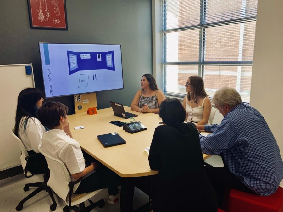 Priya Gregerson's INCubator group presenting Testing123 to two mentors for  mentor match day.