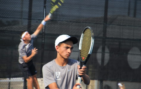 Varsity tennis players, Zach Fowler and Zach Quattro, practicing for bi-districts.