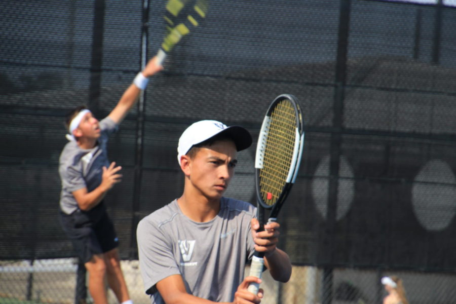Varsity+tennis+players%2C+Zach+Fowler+and+Zach+Quattro%2C+practicing+for+bi-districts.+
