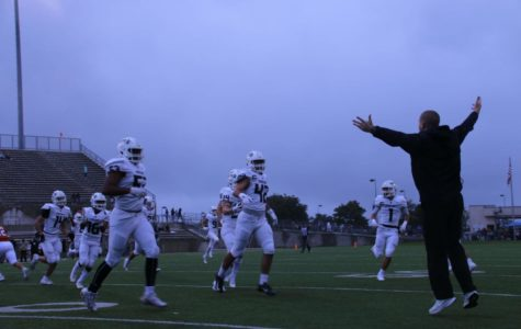 Coach Sanders cheers on a big play during Westwood game.