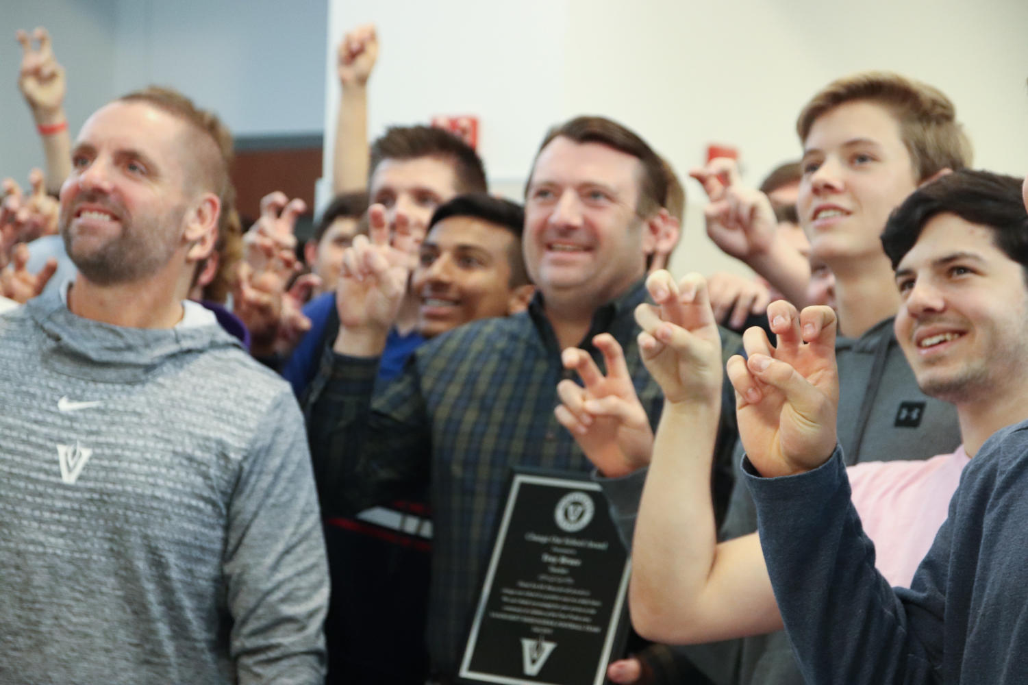 The football team surprised Bruce with the award during PIT on Monday.