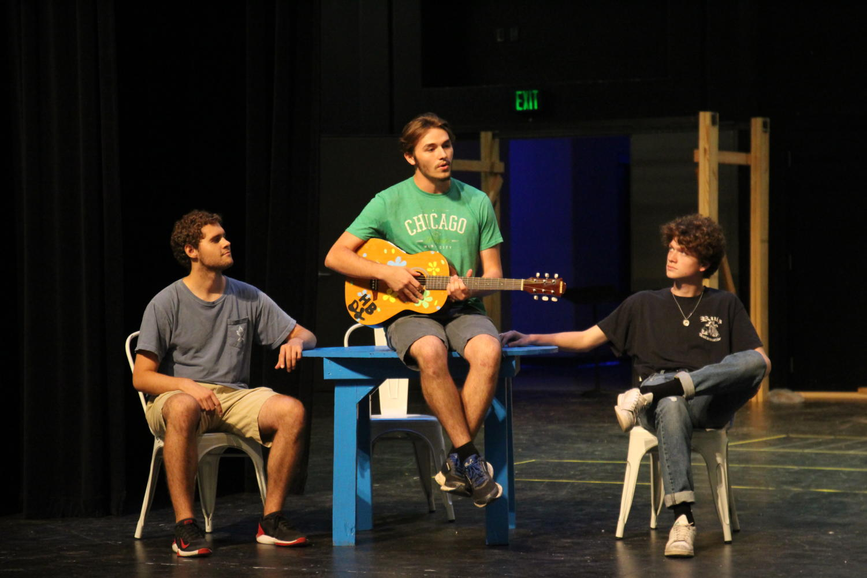 Seniors Sam Smoot, Zander Harrison and Mick Smith (left to right) perform