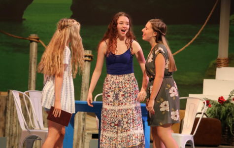 Lawrence [middle] performing a musical number during opening night of