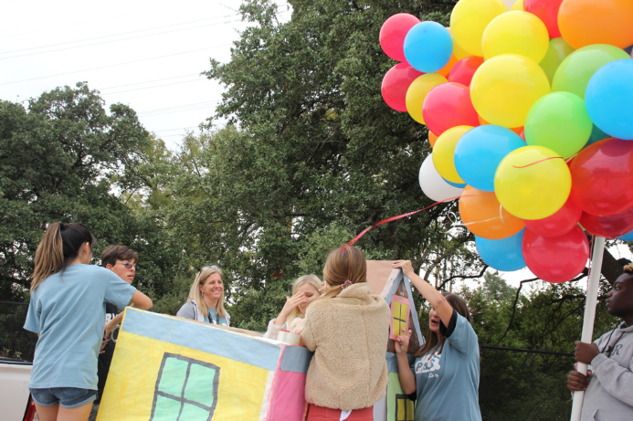 Members of PALS work together to put up their float.