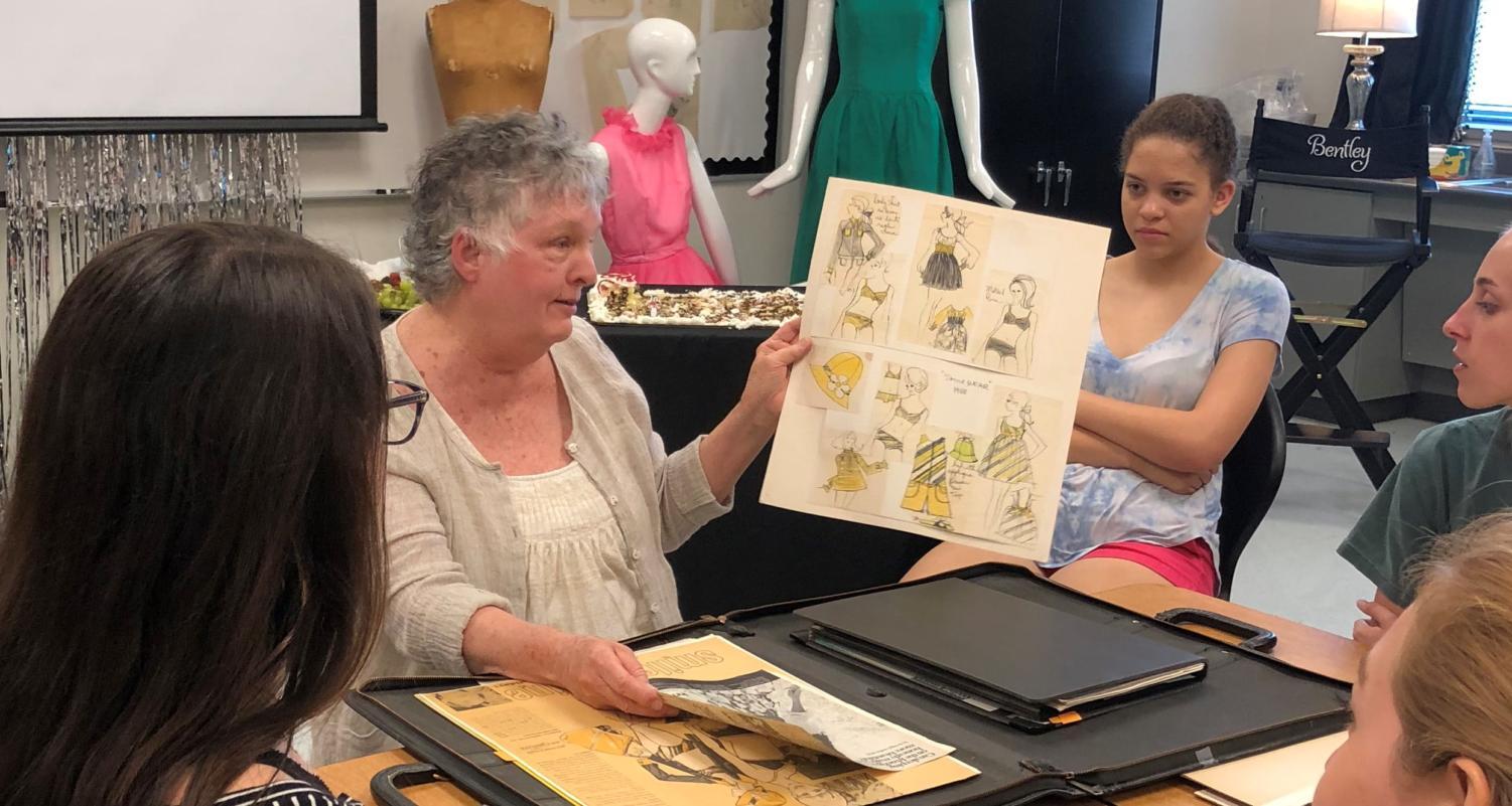 Carol Fergus shows off old sketches to students.
