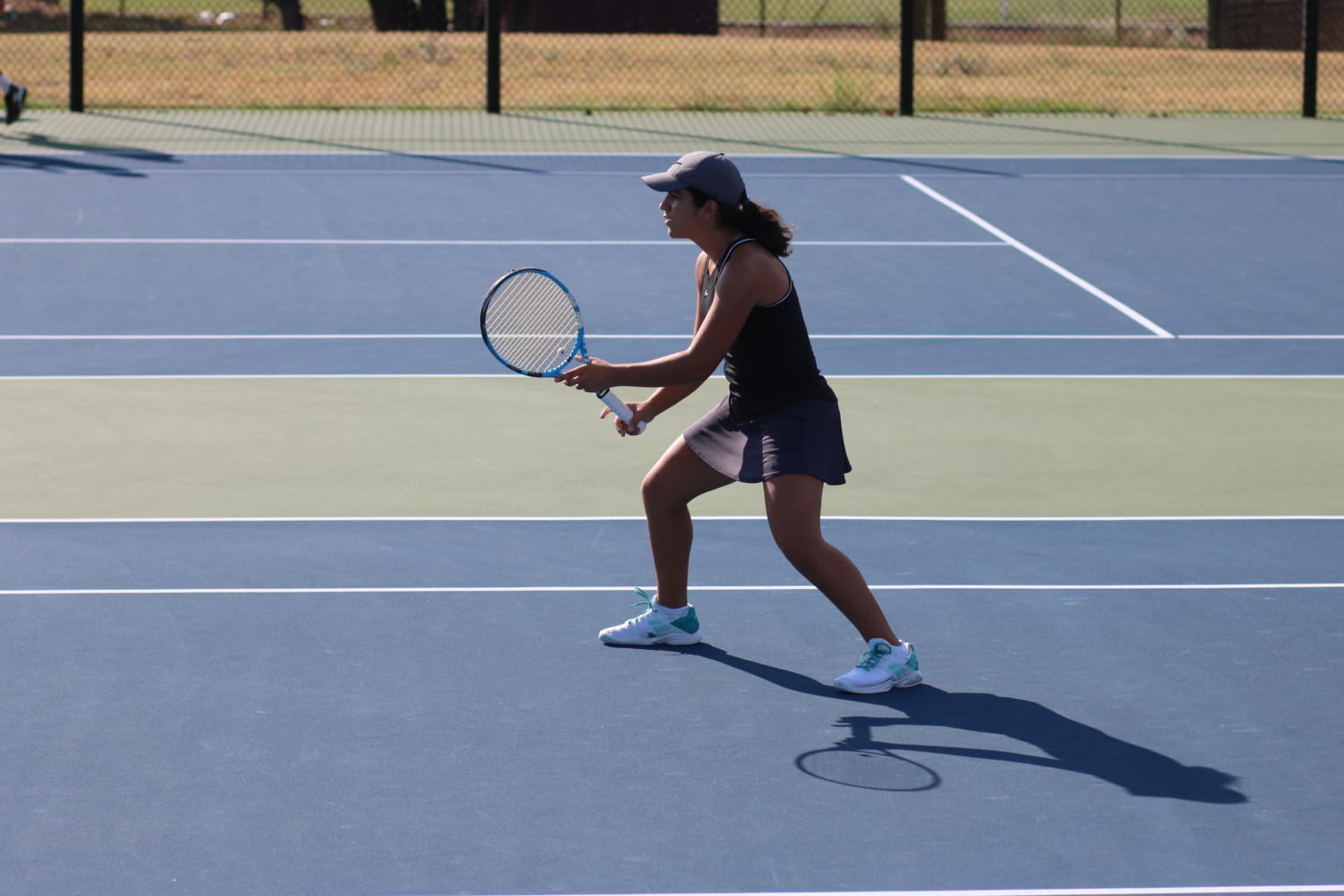 Vandegrift varsity tennis player waits for the serve during the Girls' Singles match.