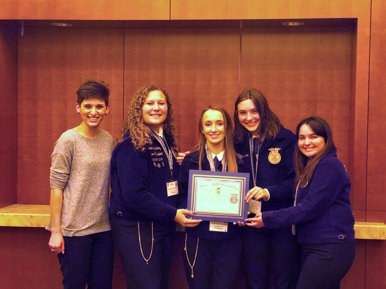 (Left to Right) Magan Escamilla, Camille Barkhuizen, Madeleine Rawlings, Noel Attwood and Tori Botello posing with their award.