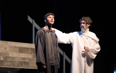 Jonas, Matthew Taylor (left), and The Giver, Mick Smith (right), share a memory onstage.