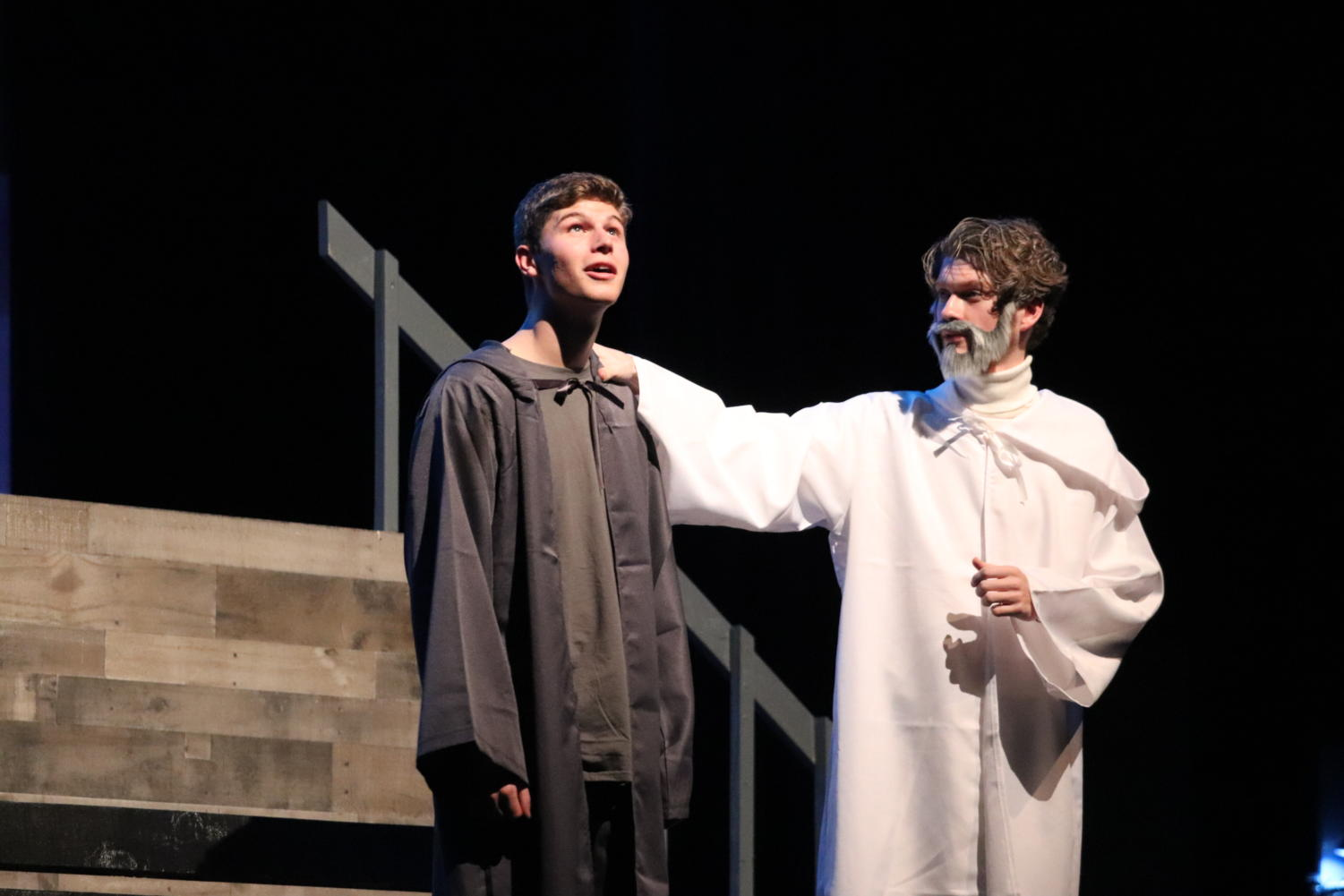 Jonas, Matthew Taylor, and The Giver, Mick Smith, share a memory onstage.