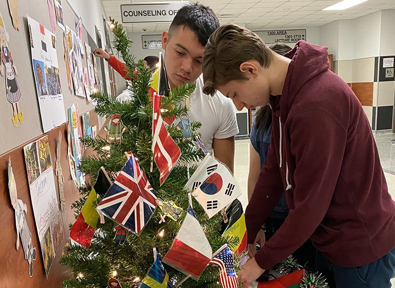 Martyn Elorz and Franciszek Jablonski finalize the diversitree decorations at the front of the school.