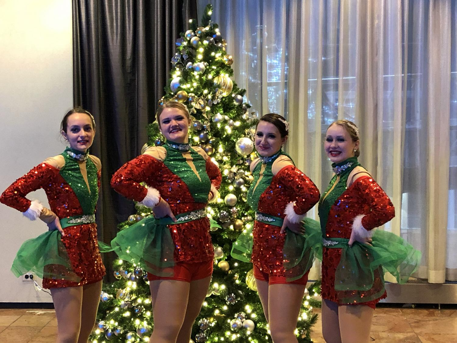 Avery Lewis, Sydney Bell, Faith Anton and Audrey Brink (left to right) pose in their uniforms on the day of the parade.