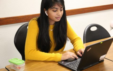 Suthar reviews her extended research paper during pit in her IB English class