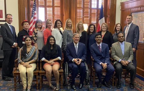 Freshman Nihar Janga takes picture with Governor Greg Abbott after winning National Geography Bee.