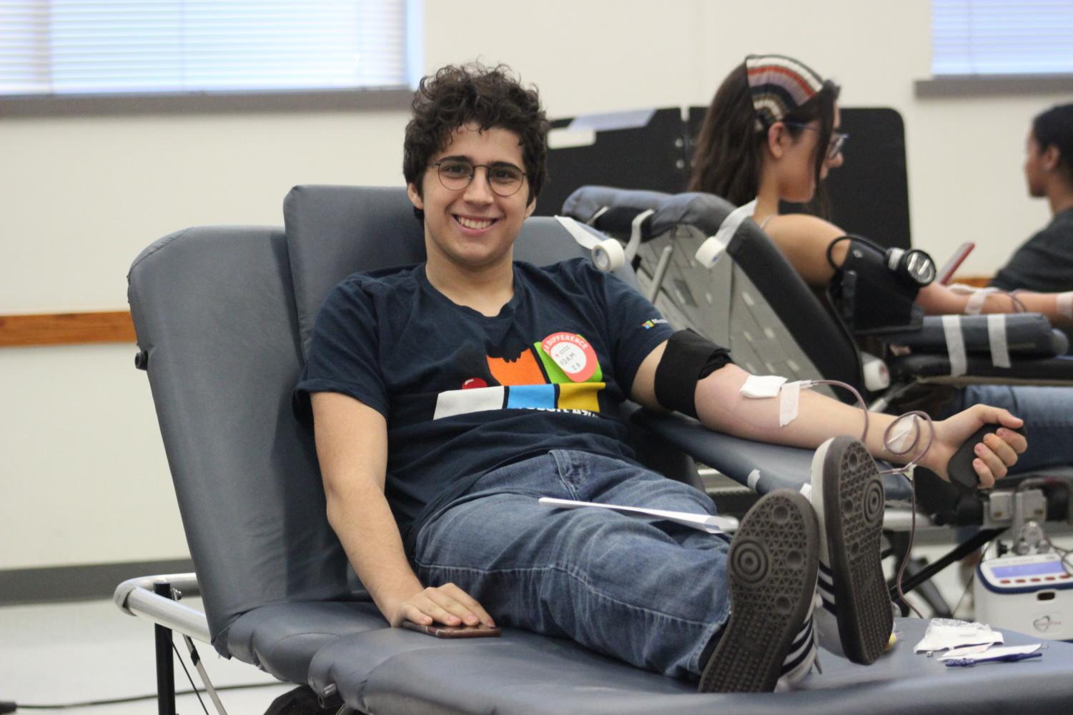 Junior Adam Tamimi participating in this year's blood drive during third period.