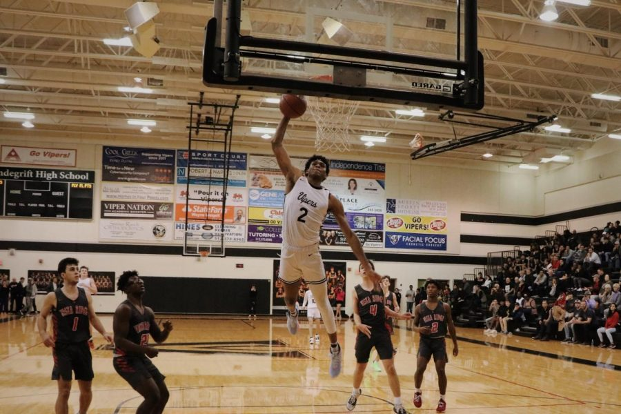 Greg Brown going for a dunk during playoff game against Langham Creek.