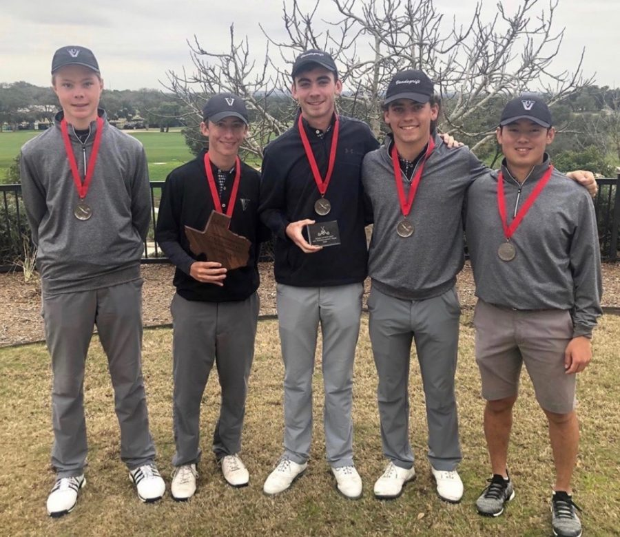 Boys+golf+players+stand+with+awards+and+medals+after+tournament.+